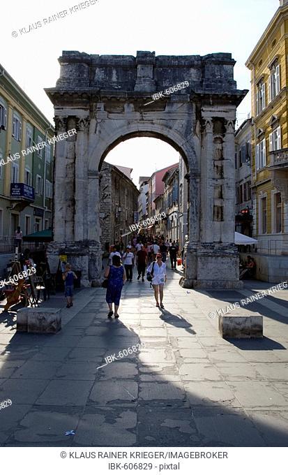 Roman triumphal arch, pedestrian zone, historic town of Pula, Istria, Croatia