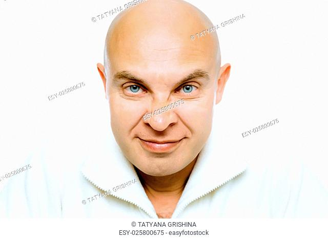 Bald evil grinning man. Isolated on white. Studio