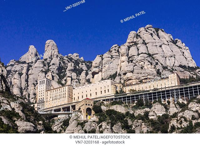 The Santa Maria de Montserrat monastery and impressive rock formation of Montserrat mountain, Catalonia, Spain. Montserrat is just over an hour from Barcelona...