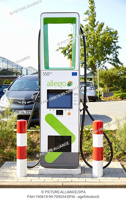 """19 June 2019, Hamburg: An ultra-fast charging column with up to 350 kW charging power will be standing on the parking lot of the garden centre """"""""Garten von..."""