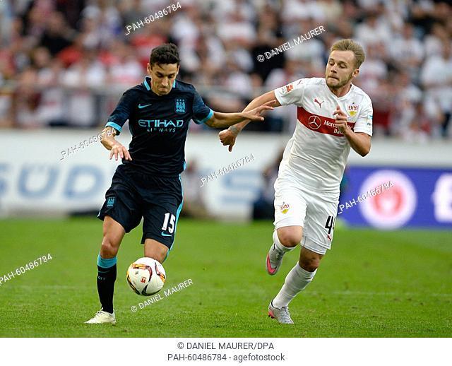 Stuttgart's Alexandru Maxim (R) and Manchester's Jesus Navas vie for the ball during a friendly between German Bundesliga soccer club VfB Stuttgart and...