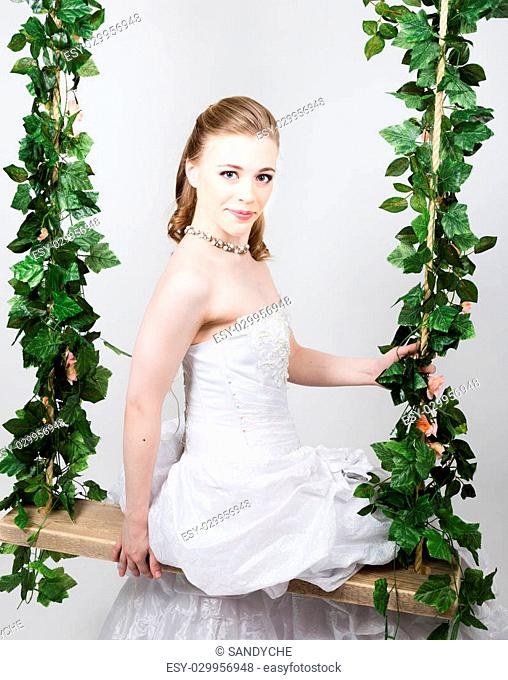 Beautiful bride with fashion wedding hairstyle. Close-up portrait of young gorgeous bride. Wedding