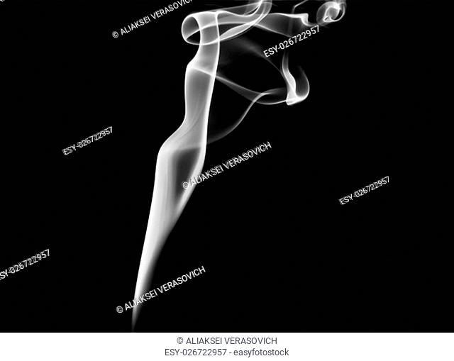 Abstract white smoke swirl on black background. Photo