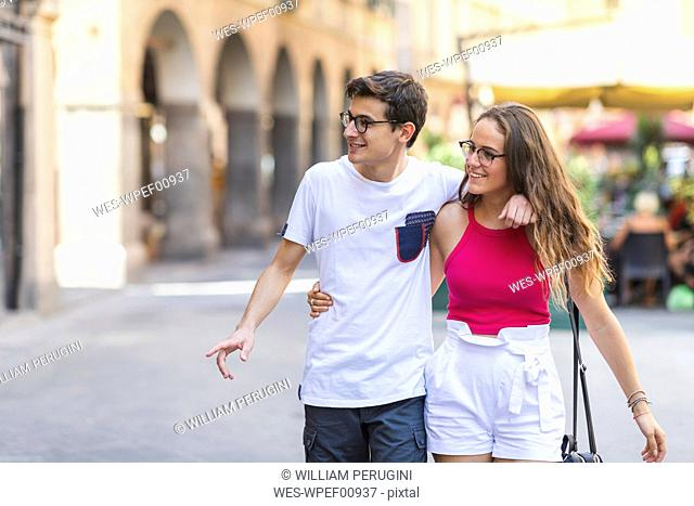 Young couple walking together in the city