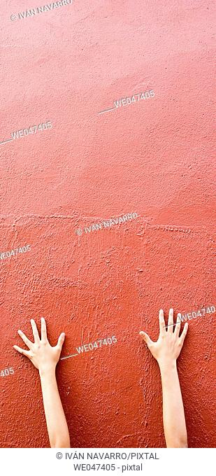 Hand on red wall