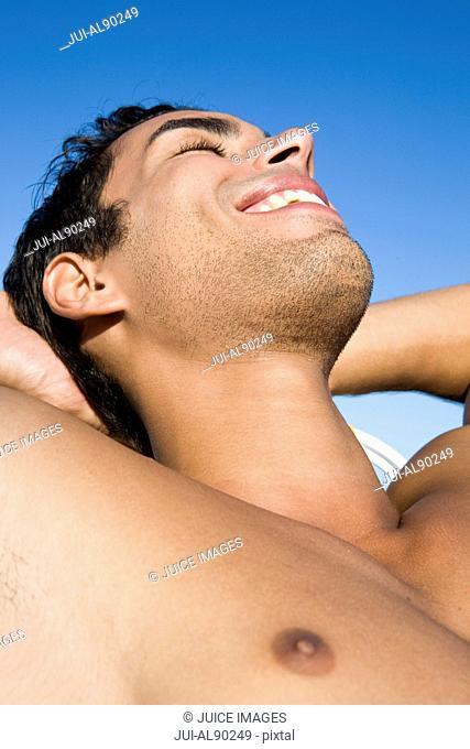 Close up of man sunbathing