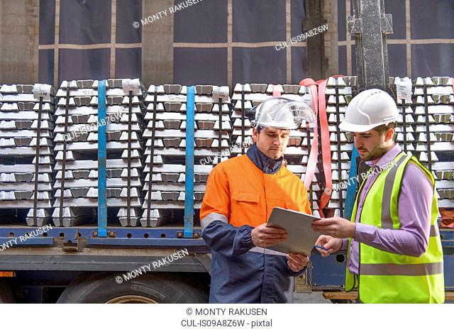 Warehouse workers checking truck cargo