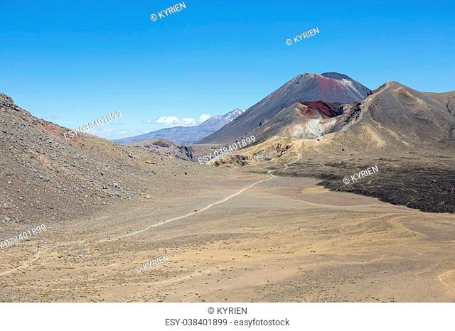 A path leading from Mount Ngauruhoe over the Red Crater to the Blue lake with Mounts Ruapehu in the back