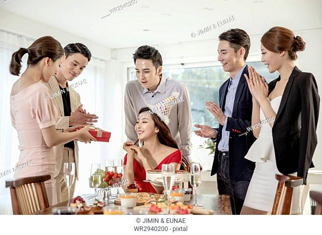 Young smiling people at party
