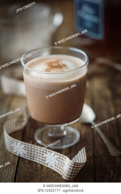 A glass of chamois milk with cocoa, tea and rum, chamois milk bar in Obertauern, Austria