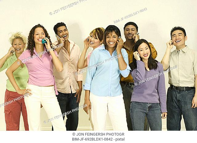 Group of friends on cell phones