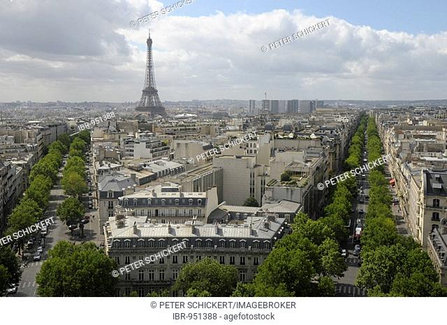 Eiffel tower viewed across the roofs of Paris, France, Europe