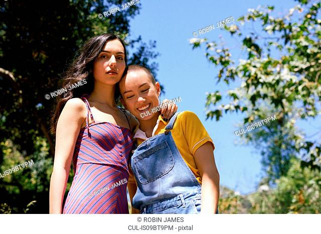 Two young female friends in park, portrait, Los Angeles, California, USA