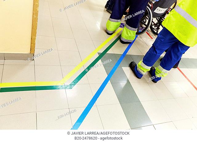 Men in reflective clothing standing in corridor, Emergency area with guiding coloured lines to different departments, Triage, Emergency room, Hospital Donostia