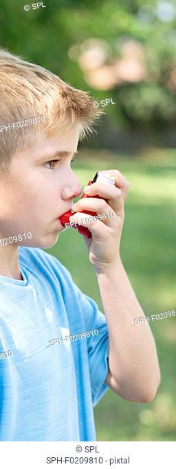 Young boy using an inhaler
