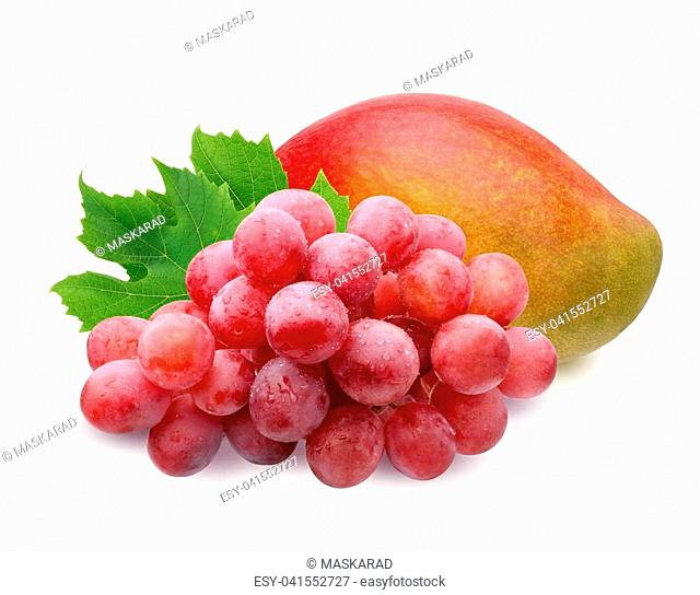 ripe mango and brush of red grapes with water drops with leaves, isolated on white background. fruit, berries, food