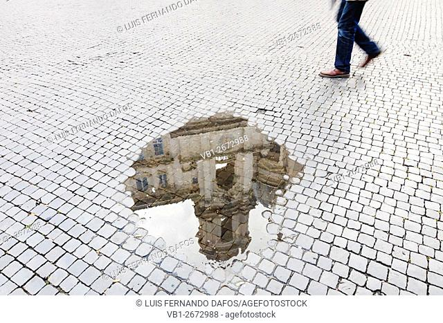 Tower of Sant'Agnese in Agone church reflected on a puddle at Piazza Navona, Rome, Italy