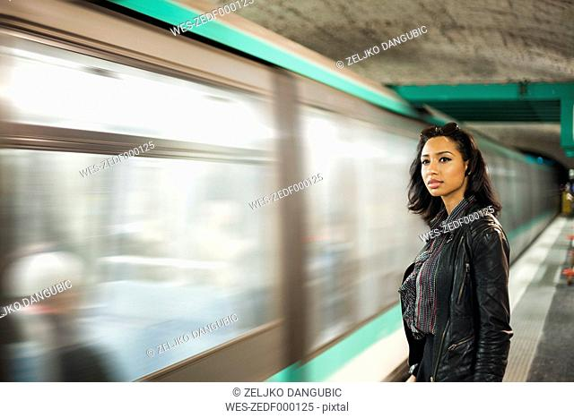 France, Paris, young woman at underground station