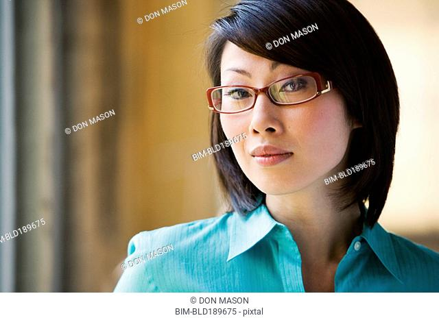 Close up of Asian woman wearing eyeglasses