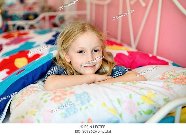 Portrait of girl lying on bed