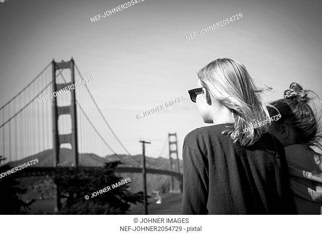 Two girls looking at Golden Gate Bridge