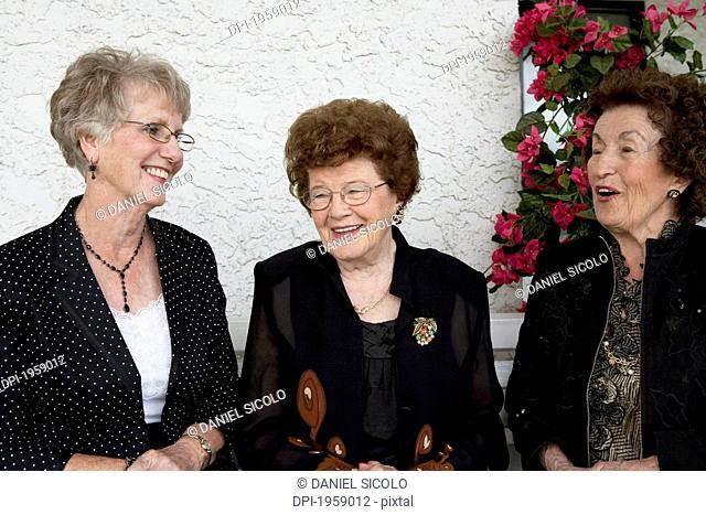 Three Women Talking Together; Edmonton, Alberta, Canada