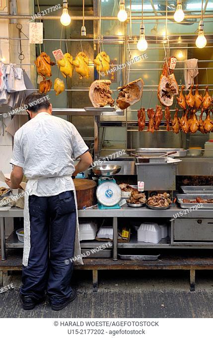 Hong Kong, China, Asia. Hong Kong Kowloon. Butcher at work