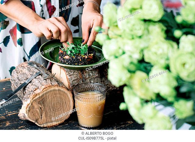 Woman preparing vegetarian dish