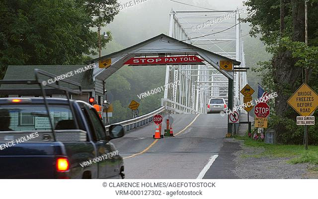 DINGMANS FERRY, PA - AUGUST 5: Commuters stop and pay the toll before crossing Dingman's Ferry Bridge on August 5, 2014 in Dingmans Ferry, Pennsylvania