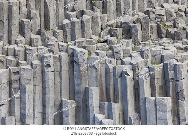 Massive basalt outcrop on the black sand beach at Renisfjara in Iceland