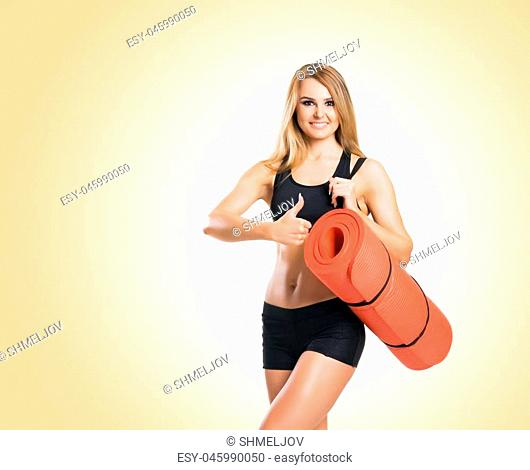 Fit, healthy and sporty woman in sportswear over yellow background