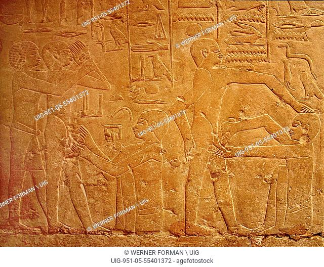 A detail of a relief in the tomb of Ankhmahor at Saqqara depicting a priest performing ritual circumcision on a young boy