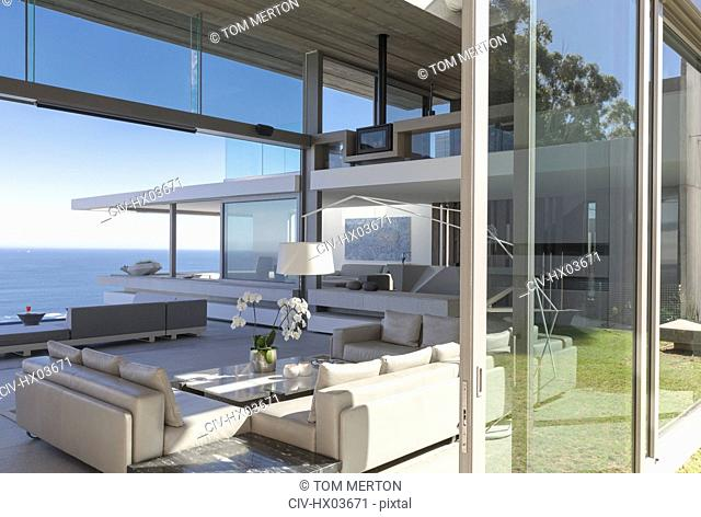 Modern, luxury home showcase interior living room with ocean view
