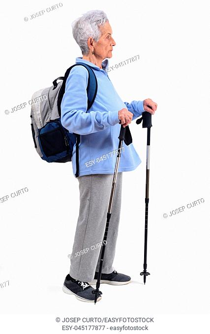 senior woman hiker on white background