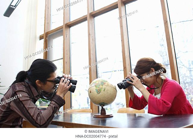 A couple looking at globe