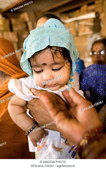 Portrait of childhood girl at Amrae an NGO at Nehru Nagar ; Golibar Slum ;Santacruz ;Bombay Mumbai ; Maharashtra ; India