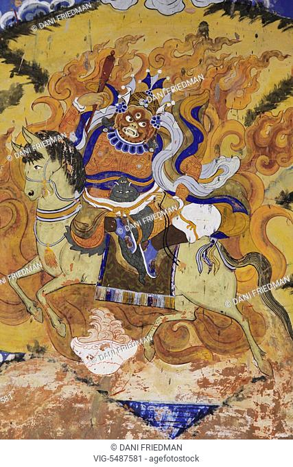 An ancient fresco of the Tibetan Buddhist deity Palden Lhamo painted on a wall at Thiksay Gompa in Ladakh, India. Palden Lhamo is a protecting Dharmapala of the...