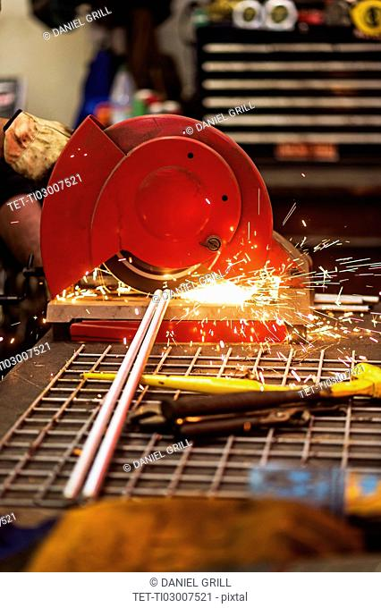 Close-up of welder grinding