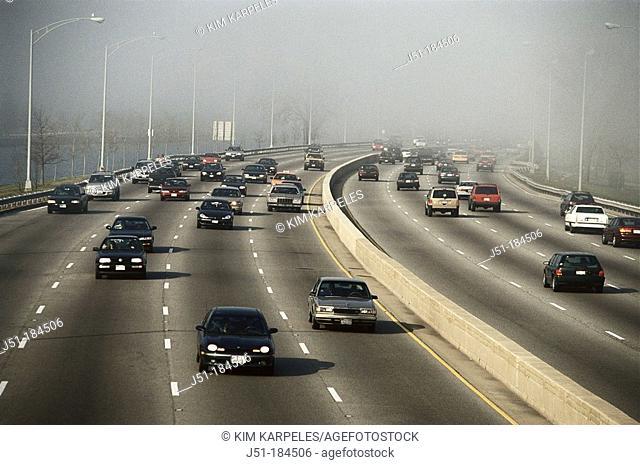 Traffic in lakefront fog. Illinois. USA