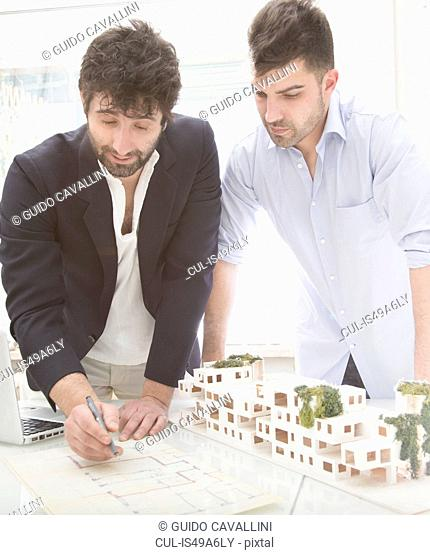 Men looking at architectural plans