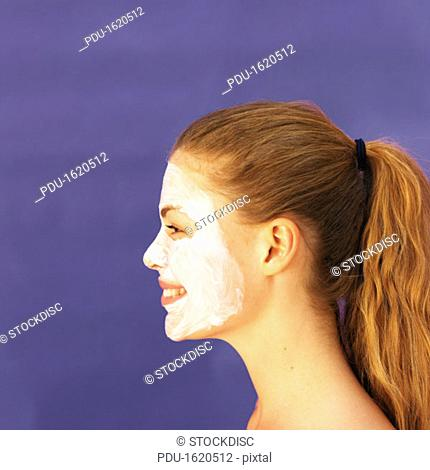 Side view of young woman wearing face mask