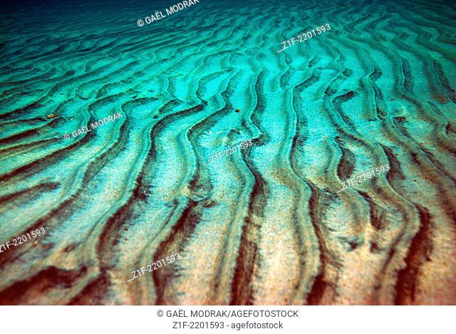 The sand stripes under the water surface in Corsica