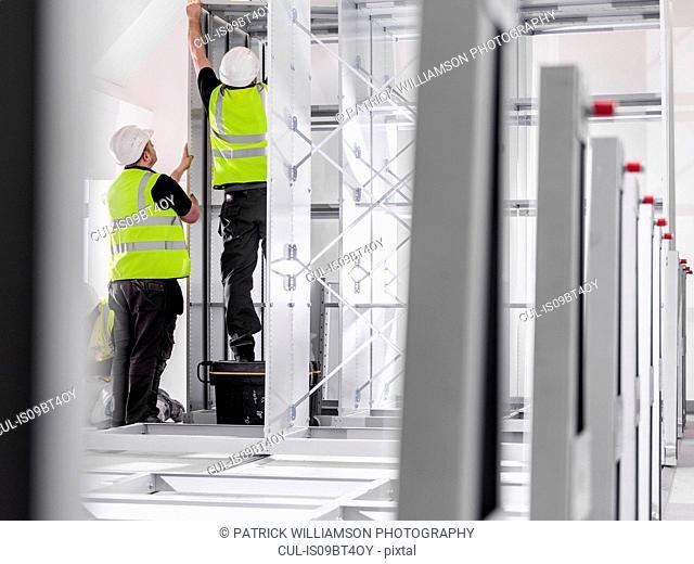 Men putting up metal structure
