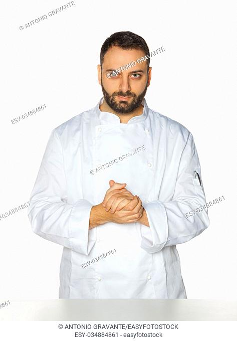 Young chef in white uniform without hat isolated on white background