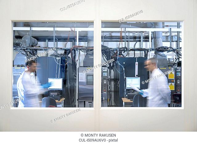 Scientists in lithium ion battery test facility in battery research facility