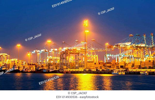 night view of with cranes and containers in port