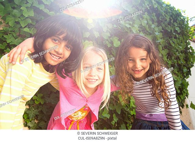 Portrait of three girls in garden