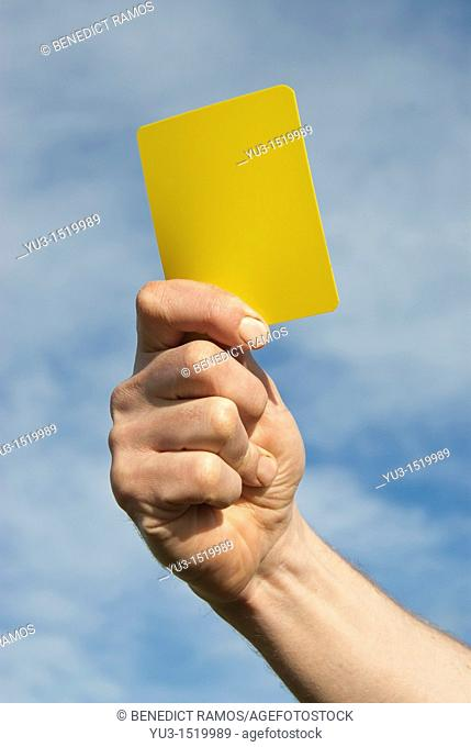 Referee waving yellow card