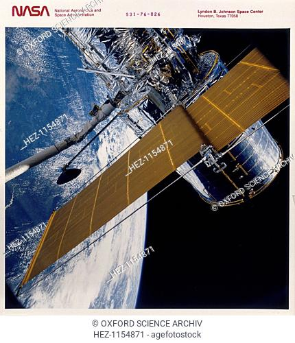 Deployment of the Hubble Space Telescope, 1990. The Hubble Space Telescope (HST) was put into orbit from the Space Shuttle Discovery