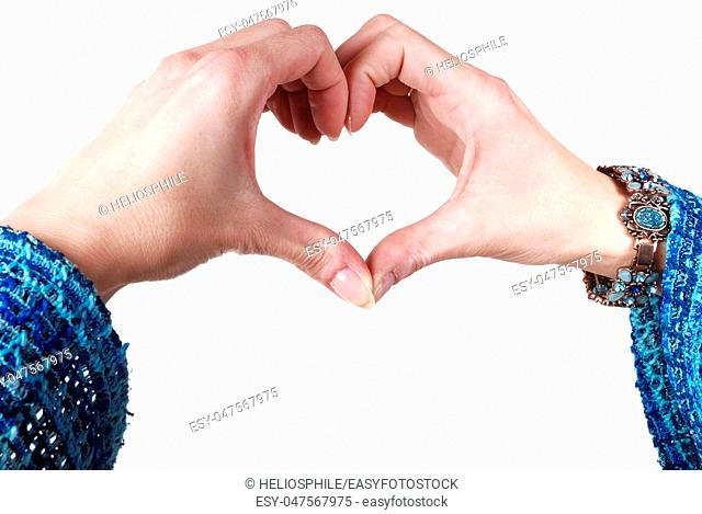 Woman making heart shape with her hands